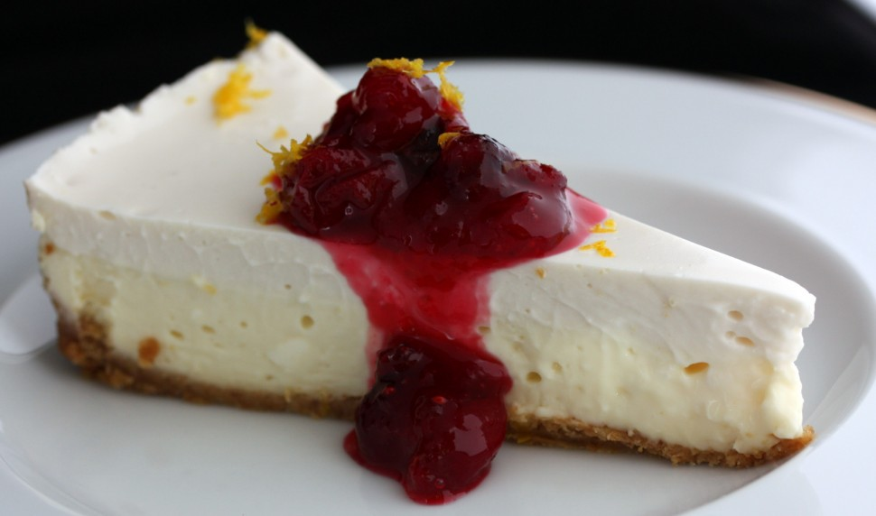 Two layer cheesecake with cranberry orange compote