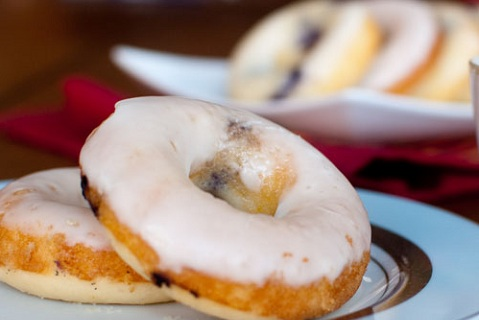 Orange glazed blueberry donuts