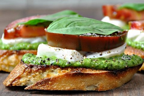 Caprese Crostini with Pesto from Pinch and Swirl